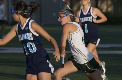 Girls&#8217; lacrosse breezes by Leland Chargers on Senior Night